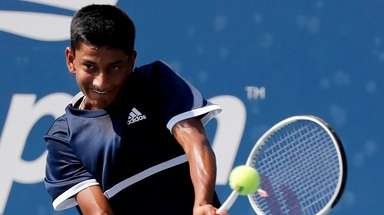 Neel Rajesh with the backhand return against Hugo