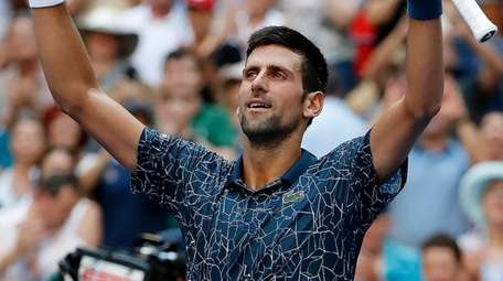 Novak Djokovic reacts after his three-set victory over