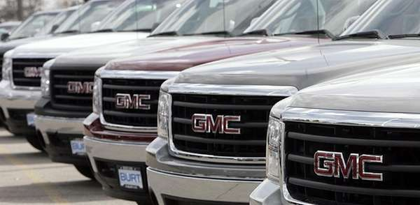 A row of GMC Sierras on the lot.