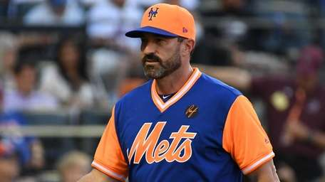 Mets manager Mickey Callaway walks to the dugout