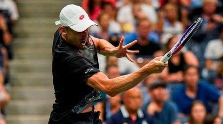 John Millman returns the ball to Roger Federer
