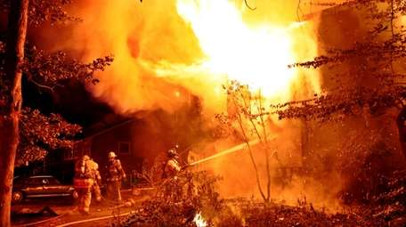 Firefighters battle a house fire early Tuesday morning