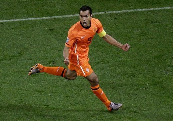 Netherlands' Giovanni van Bronckhorst celebrates after scoring a
