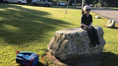 Corey Benzing, 5, of East Yaphank, waits for