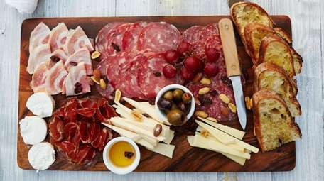 """Cured meat and cheese """"Big Board"""", or charcuterie,"""
