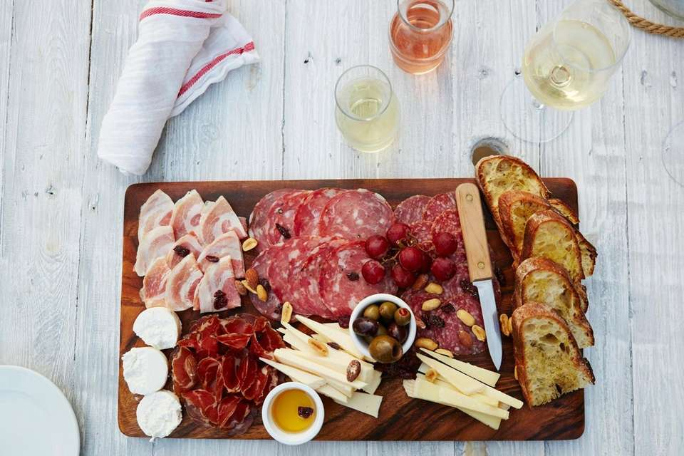 "Cured meat and cheese ""Big Board"", or charcuterie,"