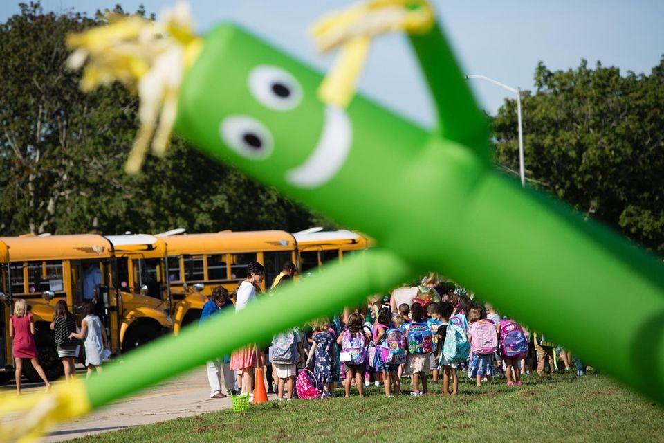Kindergartners arrive at Charles E. Walters Elementary School