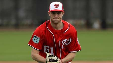Nationals pitcher Kyle McGowin fields ground ball during