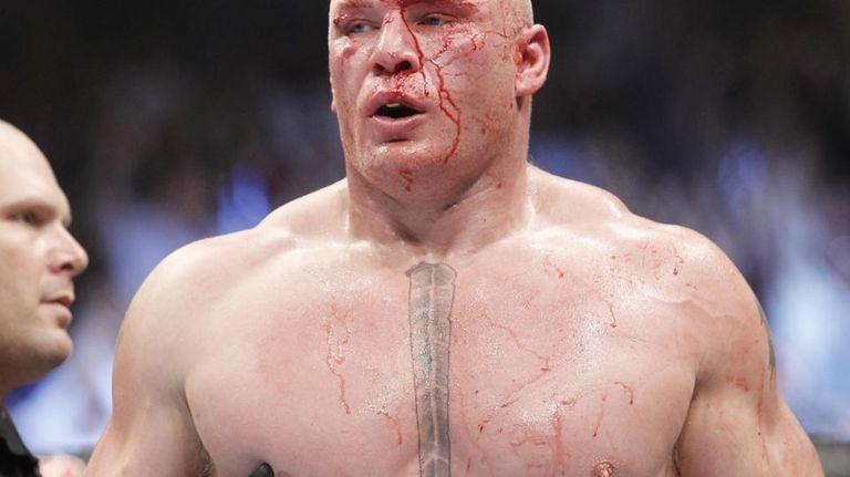 Brock Lesnar walks to his corner at the