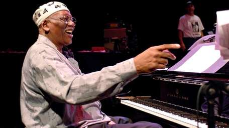 Randy Weston prepares for a performance at Queen