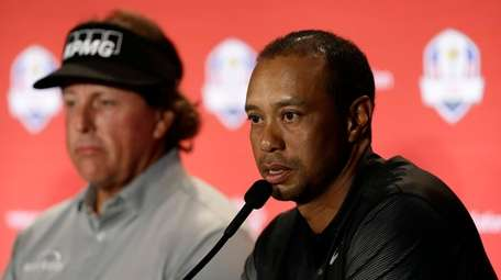 Tiger Woods speaks during a news conference with