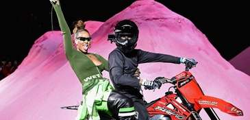 Rihanna rides a dirtbike on the runway at