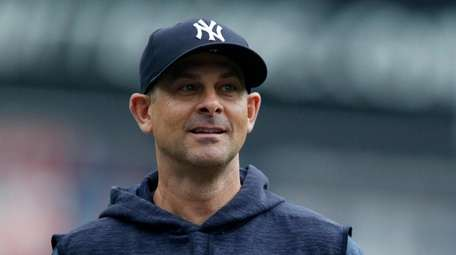 Manager Aaron Boone #17 of the New York
