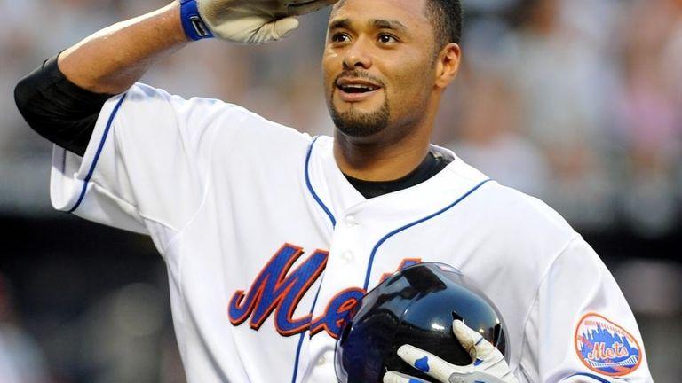 The Mets' Johan Santana salutes after hitting a