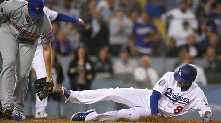 The Dodgers' Manny Machado scores a run as
