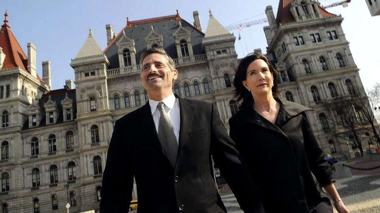 Steve Levy walks with his wife, Colleen West,