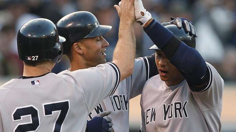 The Yankees' Alex Rodriguez, right, is congratulated by