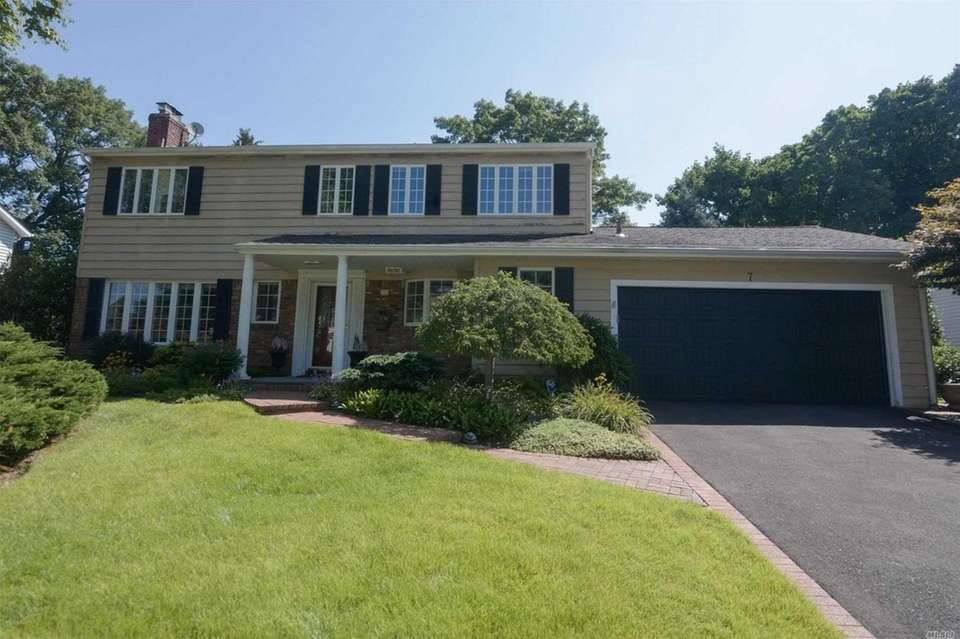 This Oyster Bay Colonial includes five bedrooms and