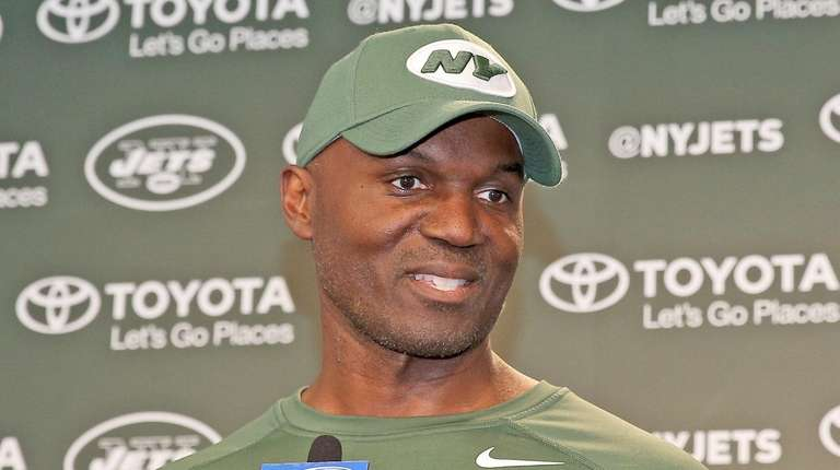 Coach Todd Bowles talks to the media at