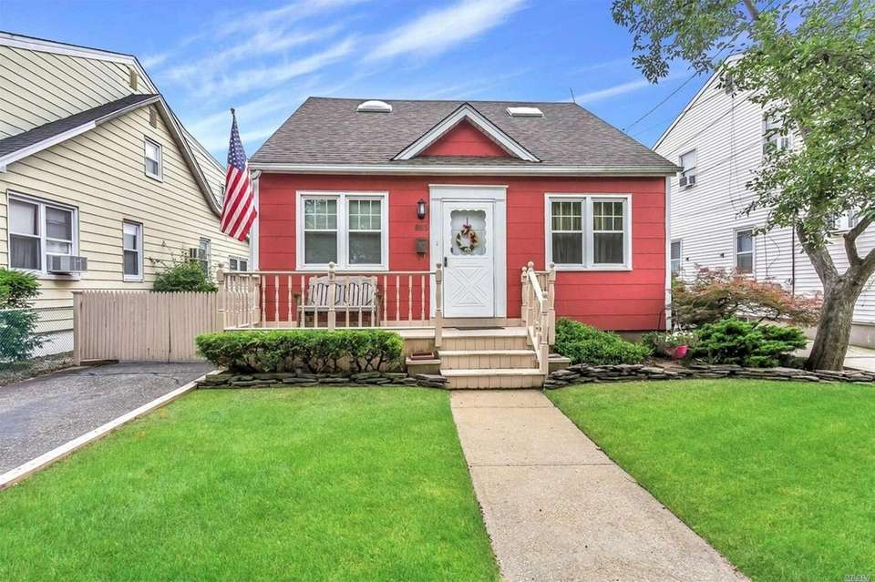This Bellmore expanded Cape includes three bedrooms and