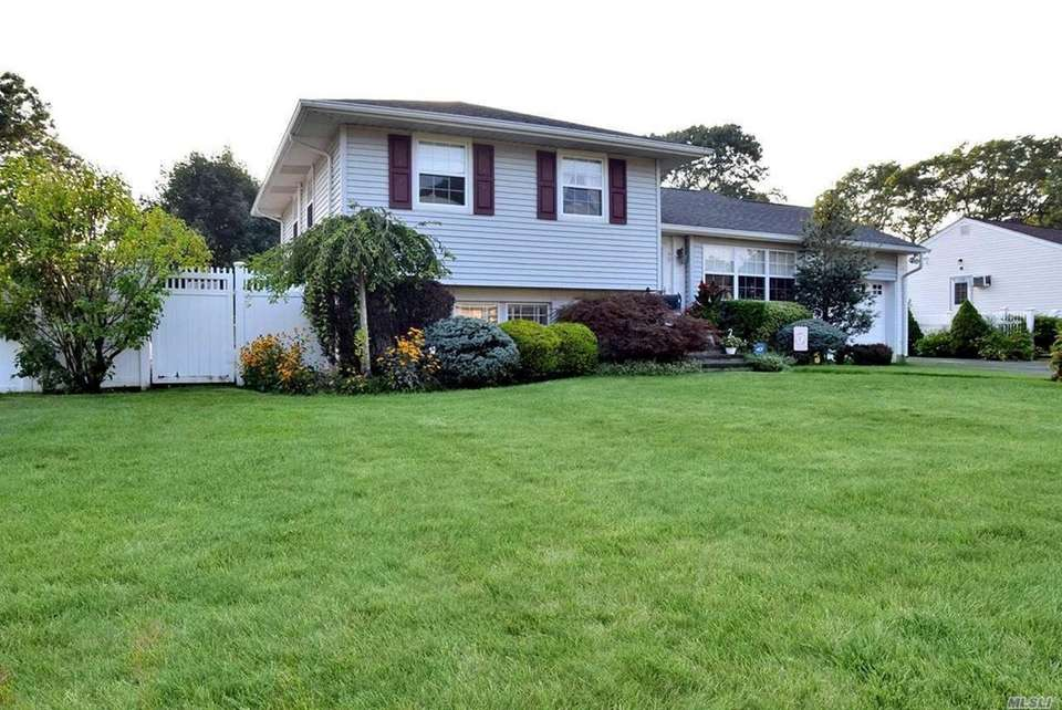 This East Islip split-level offers three bedrooms and