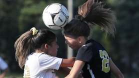 Sachem North's Jessica Nischio #18 and Commack's Katie