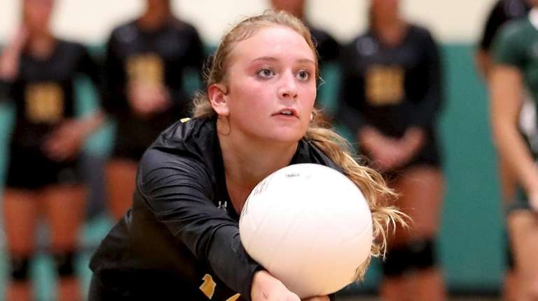 Commack girls volleyball captain Abbey Dummler gets the