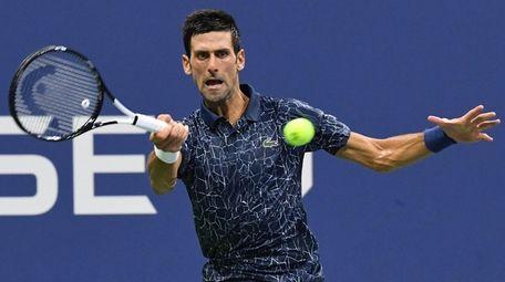 Novak Djokovic returns to John Millman during a