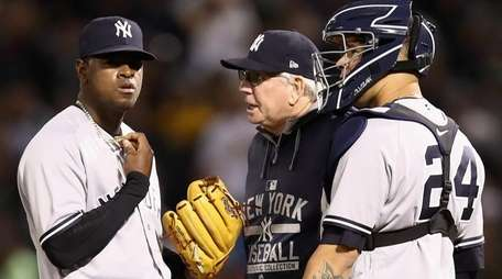 Luis Severino talks to pitching coach Larry Rothschild