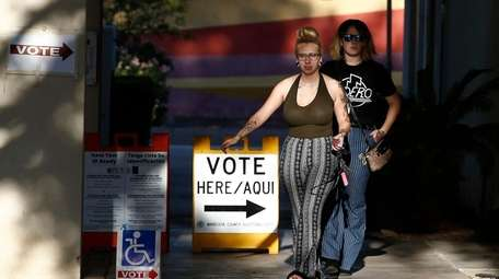 Voters exit a polling station on primary election