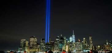 The 'Tribute in Light' rises above the skyline