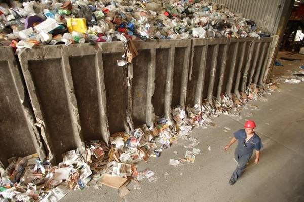 A worker at the Town of Brookhaven's Recycling