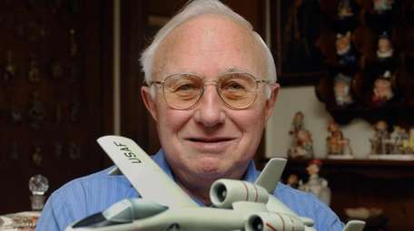 Elliot Kazan, seen in 2003, holds a model