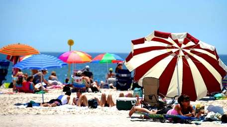Bathers take advantage of the hot weather by