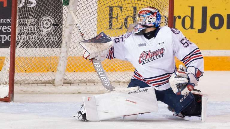 Jeremy Brodeur (56) of the Oshawa Generals watches