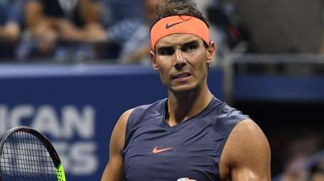 Rafael Nadal reacts against Dominic Thiem during a