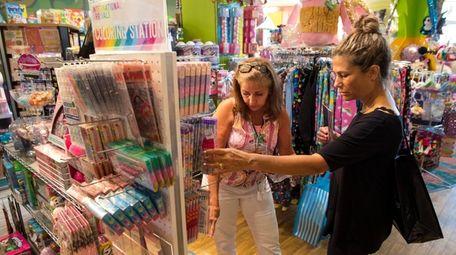 Cecilia Sanossian, left, helps customer Susan Director of