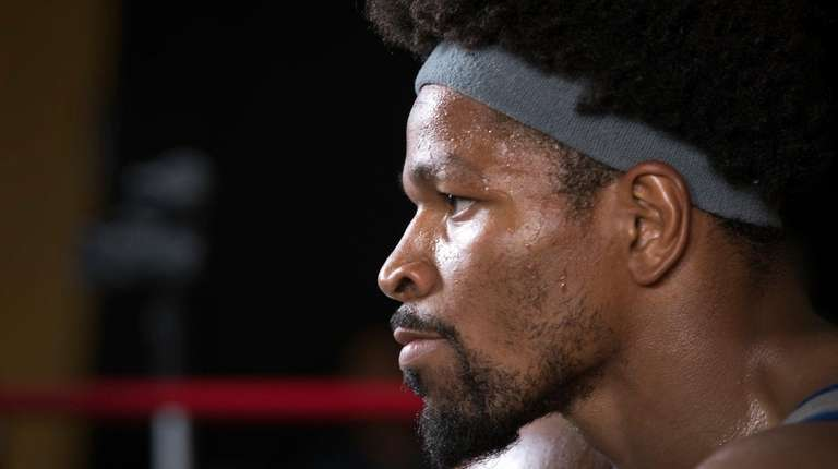 Shawn Porter looks into a mirror during a