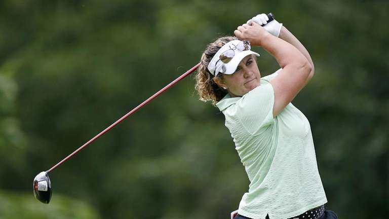 Becky Lucidi hits her tee shot on the