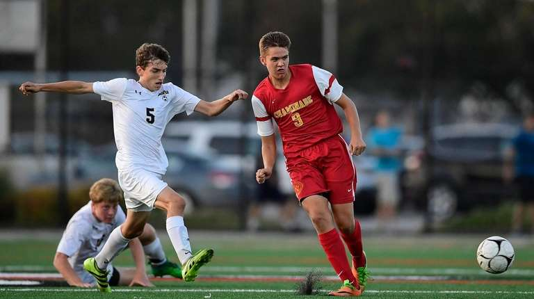 Brendan Slattery #9 of Chaminade is defended by