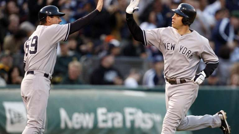 New York Yankees' Mark Teixeira, right, is congratulated