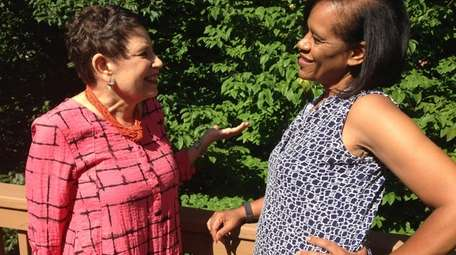 Rhoda Margolis, left, and Gail Collier-Glover talk about