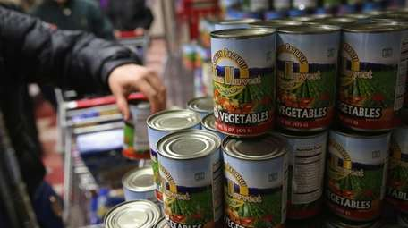 Harlem residents choose free groceries at the Food