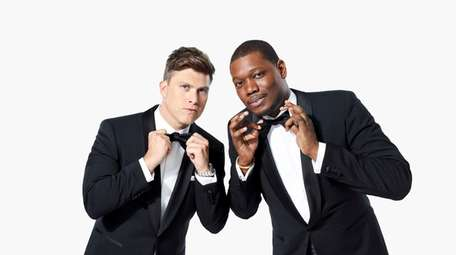 Colin Jost, left, and Michael Che will host