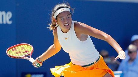 Lea Ma readies a forehand return against Lenka