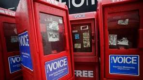 Plastic newspaper boxes for The Village Voice stand