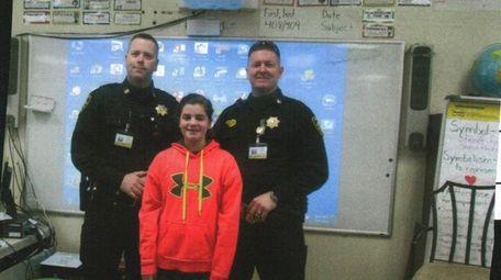 Kidsday reporter Ella Parkinson with deputy sheriffs Brian