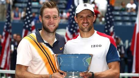 Jack Sock and Mike Bryan celebrate with the