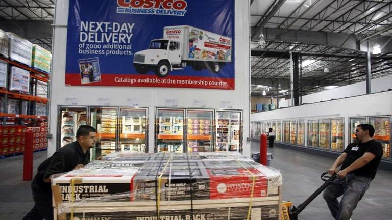 Employees move merchandise at Costco Wholesale Los Feliz