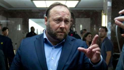 Alex Jones, the right-wing conspiracy theorist, walks the